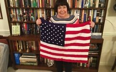 Olive Ellner holds one of the 24 blankets being donated this Veterans Day.