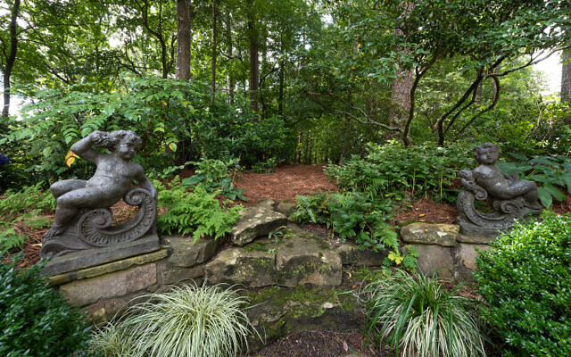 Photo by Chris Nelms VSI Photography //  Susie's carefully planned gardens overlook the river