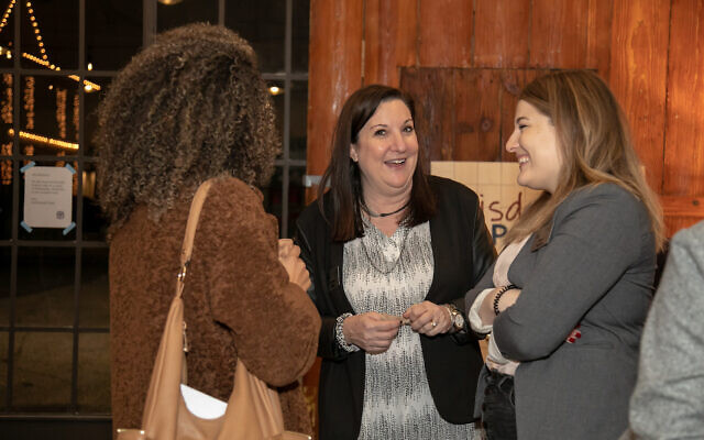 Cherini Ghobrial, Melissa Miller and Isabel Raner make connections during Wisdom Pairings.