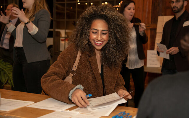 Cherini Ghobrial checks in to the Wisdom Pairings event, a night of community building and connections for Jewish Atlanta.