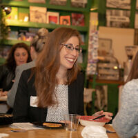 Ally Berman talks with a new connection at Wisdom Pairings, where members of the Jewish community came together to build mentoring relationships.