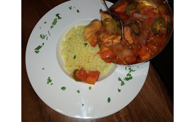 A winning entree was the Sagla's Spris ($20) salmon over rice in a well-balanced berbere sauce with tomatoes, garlic and onions. Enough for second-day leftovers.