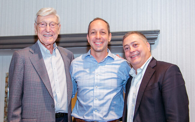 Bernie Marcus gave the commencement address at the graduation in Boca Raton, Fla., which included Geoffrey Menkowitz of Camp Ramah. Both are pictured here with Jeremy Fingerman, CEO of the Foundation for Jewish Camp.