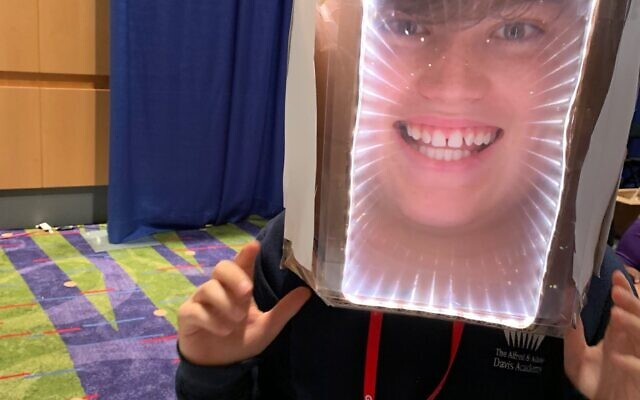 One of the projects was a Fresnel lens mask, modeled here by Jake Barras, that when worn, enlarges the head of the person wearing it.