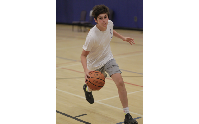 Jaeger Ouanounou, a 14-under basketball player for Team Atlanta, dribbles in practice for the JCC Maccabi Games.
