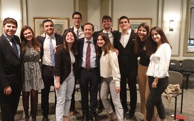 Meeting with Herzog are the 10 shinshinim, emissaries taking a gap year between high school and military service, posted in Atlanta.