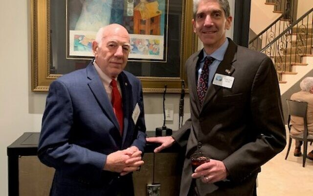 Ed Goldberg, Atlanta Advisory Council Chairman for Israel Bonds, poses with Brad Young, executive director of the agency's Southeast region.
