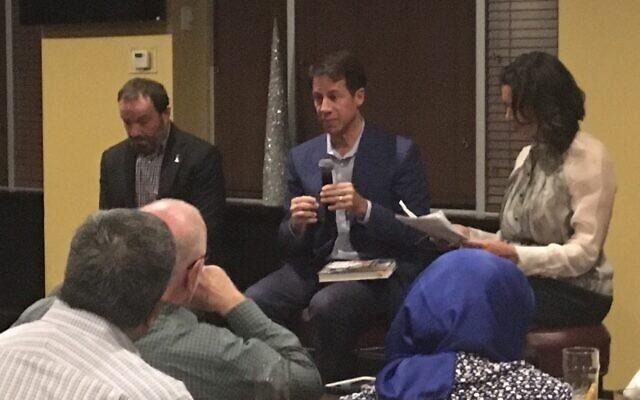 Kent Alexander, center, and Kevin Salwen discuss their book with CNN's Fredricka Whitfield at an Atlanta Press Club program.