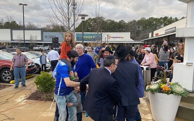 Members of Chabad of Cobb, Congregation Beth Jacob and Congregation Ohr HaTorah were among those who gathered to publicly celebrate the last night of Chanukah.