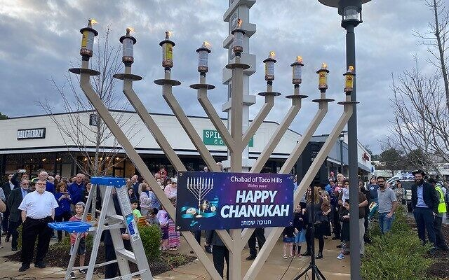 Rabbis and community members gather for a public menorah lighting in Toco Hills on the last night of Chanukah.