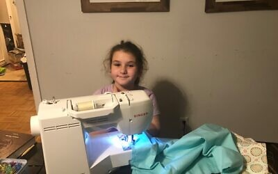 Noa Feen was hard at work sewing pillowcases for residents of Rebecca's Tent.