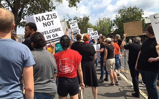 Photo by Roni Robbins // Signs protest Nazis and white supremacy at the rally.