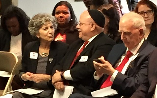 Shelley Rose, former deputy director of the Anti-Defamation League regional office in Atlanta, chats with Rabbi Steve Lebow of Temple Kol Emeth before the press conference, while former Gov. Roy Barnes checks his phone.