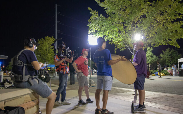 """Photos by Tommy Antonino // Behind the scenes photos show the process of making """"No Pork on the Fork."""" Here, Jody Pollack, in purple, is interviewed by Adam Hirsch, red, and Jacob Ross, blue."""