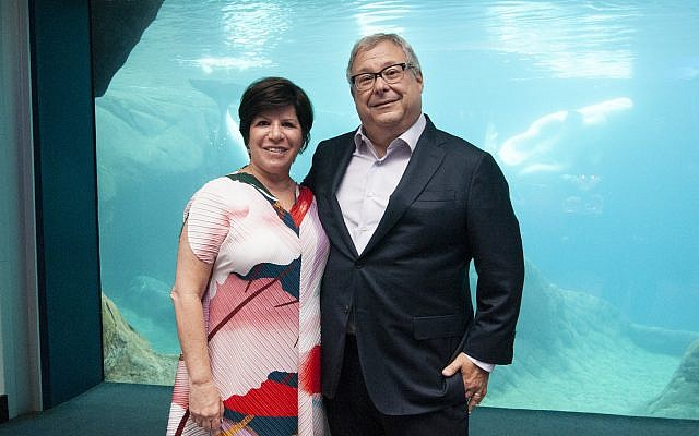 Eydie and Steve Koonin celebrate Bernie Marcus' 90th birthday at the aquarium.