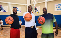 NBA Hall of Famer Dikembe Mutombo, center, will visit the AJA camp. He is pictured here with Kenny Williams, a former NBA player and Israel professional player and Rodney Zimmerman, a former UCLA and NBA player.