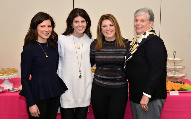 The daughters of Susan Arnovitz Saltz with Shelley Buxbaum, right, who wrote the curriculum made possible through a gift from the daughters.