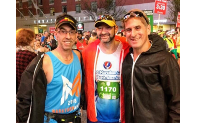Jay Spector, left, introduced Anthony Shapiro and Jeff Brown at the Jerusalem Marathon in 2015. They are pictured here at the start of the Georgia Marathon downtown three years later.