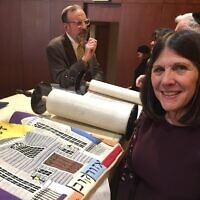 Karen Lansky Edlin stands with the Ozorkow Torah and its mantle, which she designed. Standing behind her is Rabbi Neil Sandler. The Torah, which her parents presented to the congregation in 1977, was rededicated Jan. 5.