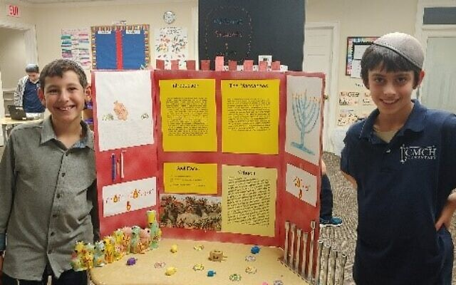 Matan Fleishman and Meir Isaacs presented the difference between a kosher and non-kosher menorah.