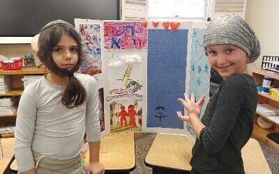 Shai Sabi and Abigayil Teytel dressed as Yaakov and Leah from parshah Vayeitzei for their Torah Fair presentation.