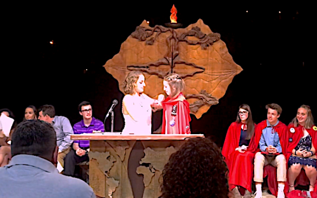 Sara Neuberger, on right, received a red cape when she was installed as president of the Southern Area Region of NFTY.