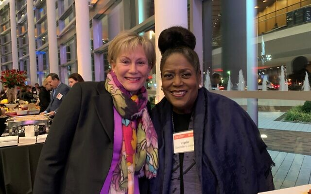 Sponsor Sheri Labovitz connects with Ingrid Saunders Jones, who committed to Coke's first AJFF sponsorship 20 years ago.