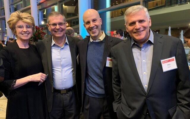 Lynne Sir Louis, Carlos Pimenta, Macquarium CEO, and sponsor Marc Adler, Macquarium chairman, mingle with Phil Kent, retired CNN CEO.