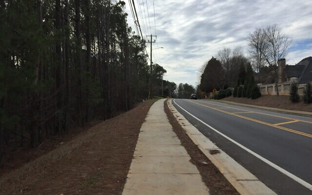 The wooded site along Spalding Drive where Chabad of Gwinnett wants to build.