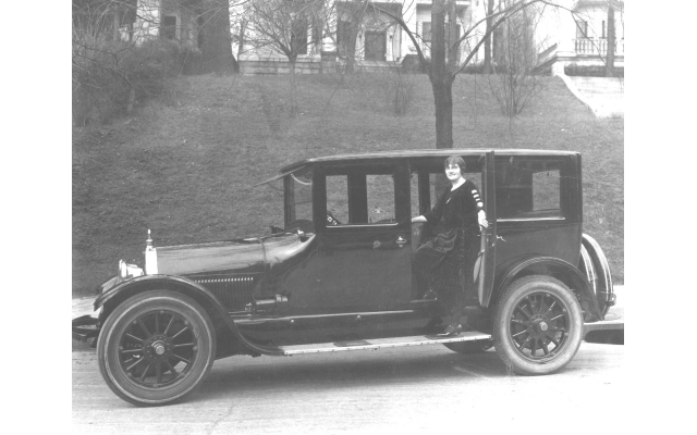 Photos from The Breman Museum archives // Ella Menko Joel stands in front of her car wearing flapper garb in 1920.