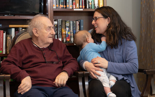 Robert Weiss enjoys his visit with JFF founder Elana Frank and baby Matan.
