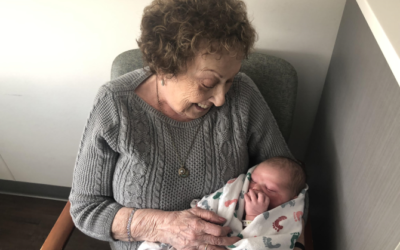 """Photos by Beth Intro // Rose, an 83-year-old resident of Berman Commons, with her great-grandson, a """"JFF baby."""""""