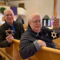 Rabbi Albert Slomovitz, left, partnered with Rev.  Raymond Cadran of the Catholic Church of St. Ann to include a Star of David ornament with every Christmas tree the church sold.