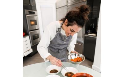 Deljou prepares lentils with braised sweet potatoes.