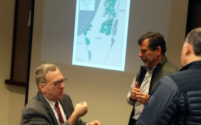 Horizontal: David Makovsky at a breakfast presentation at the ISMI Feb. 4. The map behind him overlays the 1949 Green Line, the separation barrier and areas of West Bank atop the two states envisioned by the Trump peace plan.