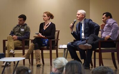 Speakers Ariel Prado, Traci Feit Love, Charles Kuck, and Amilcar Valencia take questions from the audience.