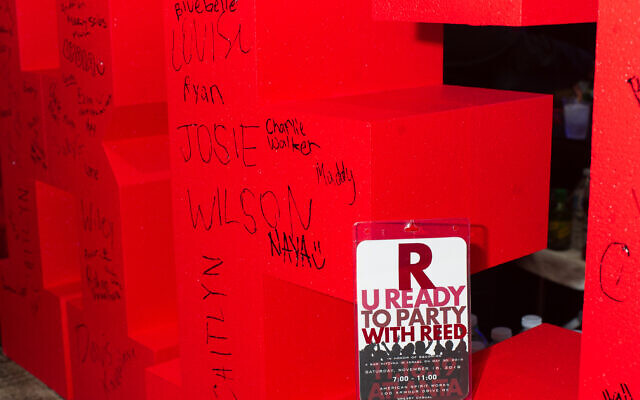"""R U Ready to Party?"" sign with red wall of Reed's name got the younger crowd in a dancing mood."