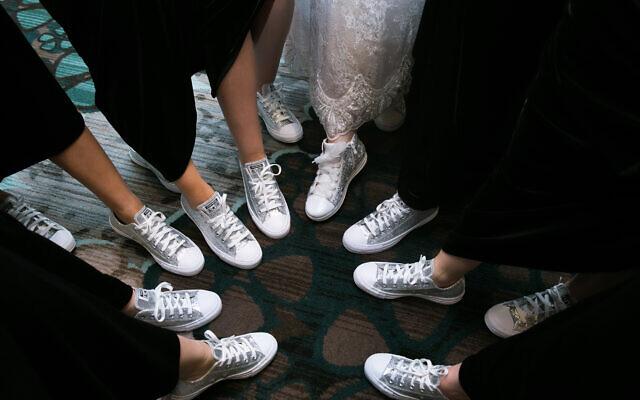 In lieu of heels, Amy's wedding party wore sneakers.