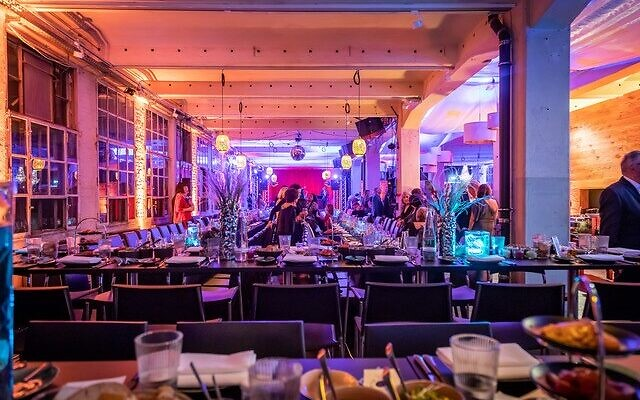 The party on the top floor of an old warehouse accommodated 120 guests.