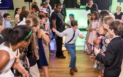 Elias shows off his dance moves.