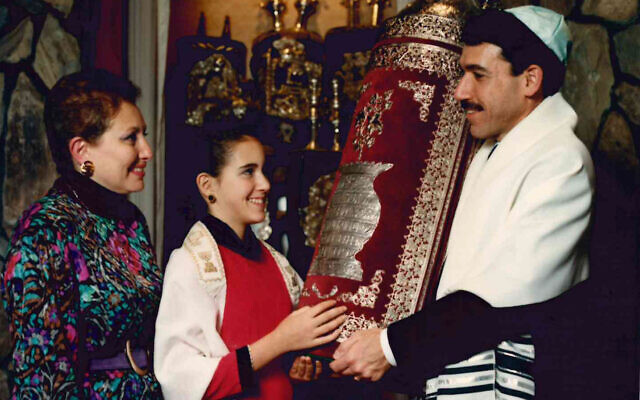 Traci Flome read from the Mizrahi Torah at her bat mitzvah in 1989 at Etz Chaim. She is pictured here with her parents, Linda and Michael Weinroth.