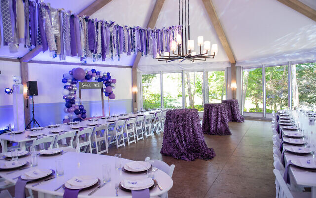 The room setup featured personalized purple napkins.