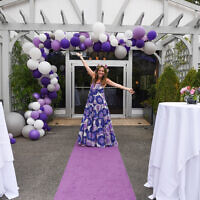 Photos by Jack Parada Photography//  Samatha welcomes guests under a purple cascade of balloons.