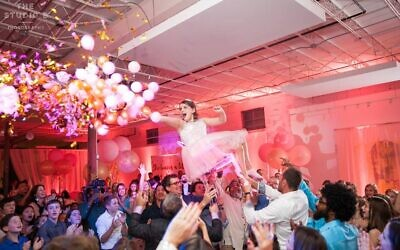 What fun to hoist the bat mitzvah to pop this Balloons Over Atlanta ceiling display!