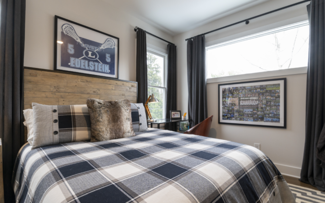 """Lacrosse player son Reid's room has a """"buttoned up"""" look with navy block plaid."""