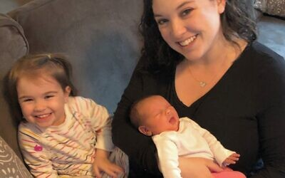 Teacher-mom Melissa Silver reads to her children, Maya, turning 3, and Elise, 3 months old.
