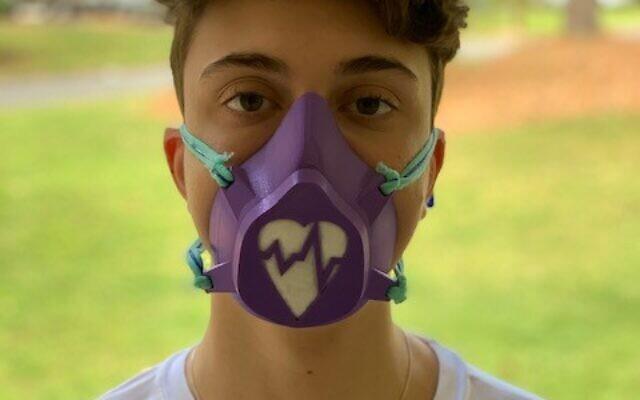 Noah Kalnitz makes masks for hospitals using filament on his 3D printer.