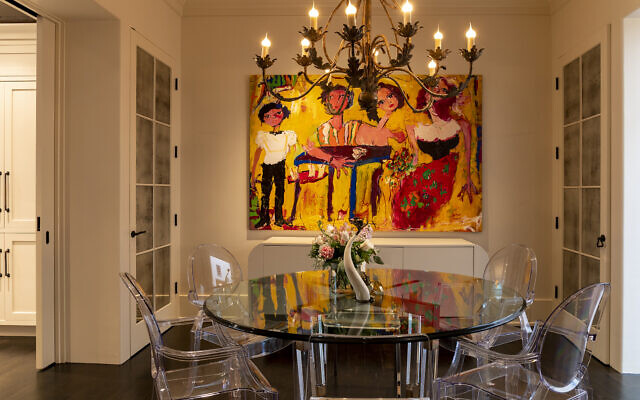 The Siegel dining room has furniture by Philippe Starck. The painting is by Astolfo Funes.