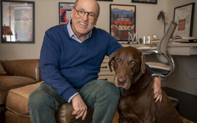 Siegel chills in his study with chocolate lab Duke.