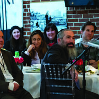Rabbi Schusterman, front right, and other professionals enjoy a Jewish Business Network event.